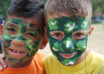 boys with camo face paint