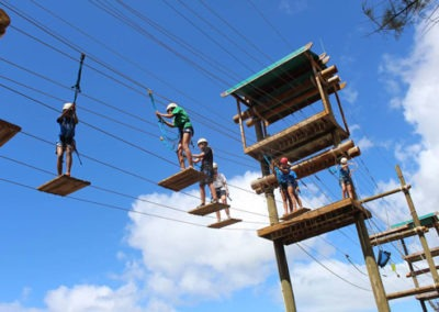 campers walking on ropes course challenge